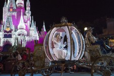 Cinderella and Prince Charming wave to Magic Kingdom
