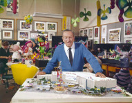 Walt Disney with mock up plans for It's a Small World